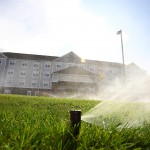 active sprinkler system in front of commercial building