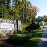 hawks ridge sign next to living community