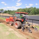 tractor hauling trenching equipment