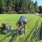 man installing irrigation system