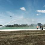 industrial sprinkler watering athletic field